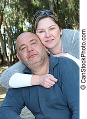 mid aged Couple - mid aged couple portrait in the park