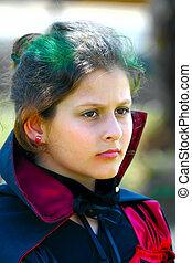 girl posing vampire costume - portrait of a little girl...