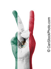 Hand making the V sign, Mexico flag painted as symbol of...