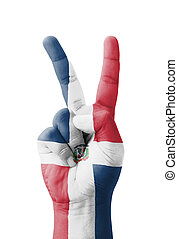 Hand making the V sign, Dominican Republic flag painted as...