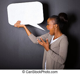 african woman screaming in blank speech bubble isolated on...