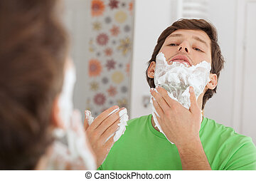 Man with shaving cream - A man putting some shaving cream...