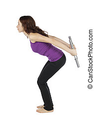 Fitness woman doing triceps kickback with weights during...