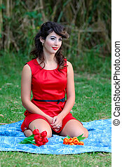 Pin-up girl - young beautiful woman portrait on a blanket at...