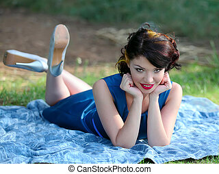 pin up girl - young beautiful woman portrait on a blanket at...