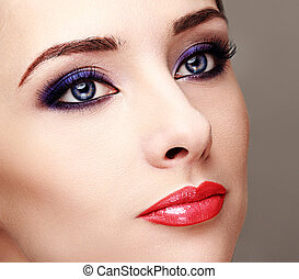 Beautiful woman with bright eyes makeup and long lashes...
