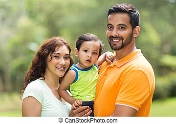 young indian family with the kid - young happy indian family...
