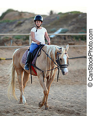 little girl and horse  - little girl is riding a horse