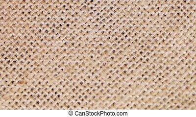 Burlap - Macro burlap fabric rotating clockwise