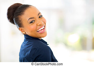 young african american businesswoman looking back