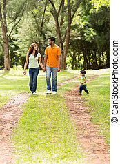 family enjoying a walk at the park