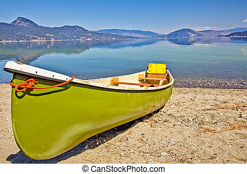 Canoe on the Lake Shore