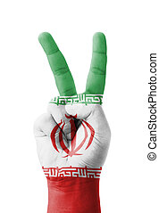 Hand making the V sign, Iran flag painted as symbol of...
