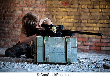 Sniper\'s life - Aiming sniper with the rifle on the brick...
