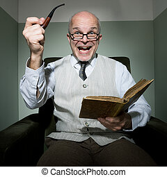 Senior reading in his living room - Senior cheerful man...
