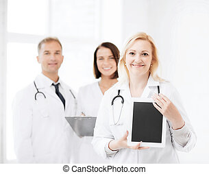 female doctor with tablet pc - healthcare, medical and...
