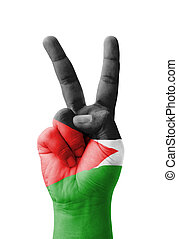 Hand making the V sign, Palestine flag painted as symbol of...