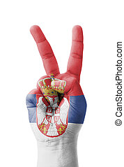 Hand making the V sign, Serbia flag painted
