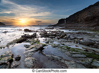 Trevellas Coombe beach in St Agnes in Cornwall - Sunset at...