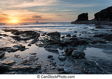 Sunset at a Rocky Cove - Sunset at Trevellas Coombe beach in...