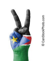 Hand making the V sign, South Sudan flag painted as symbol...