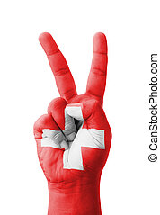 Hand making the V sign, Switzerland flag painted as symbol...