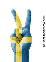 Hand making the V sign, Sweden flag painted as symbol of...
