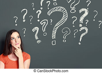 girl with question mark - young girl with question mark on a...