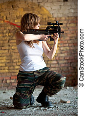 Special forces - Armed woman with the rifle on the brick...