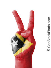 Hand making the V sign, East Timor Timor-Leste flag painted...