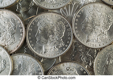 Many American Silver Dollars - Closeup horizontal photo of...