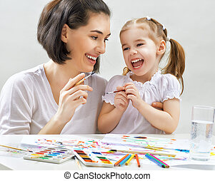 bright paints - a happy family is painting