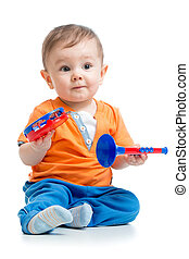 smiling boy baby  with musical toys. Isolated on white background