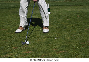 Teeing it Up on Par 3 - a golfer tees it up with a seven...