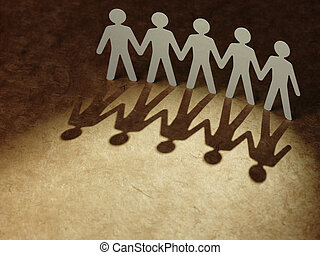 Group of paper people holding hands Teamwork concept