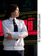 airhostess - Portrait of the airhostess in the uniform on...