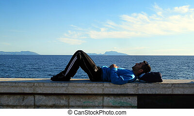 thinking lonely boy lying waterfront