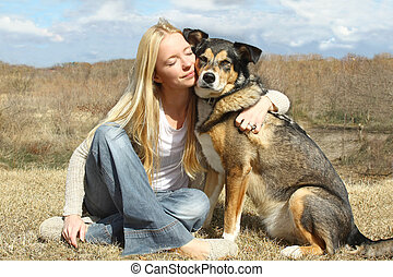 Woman Hugging German Shepherd Dog Outside - a special and...