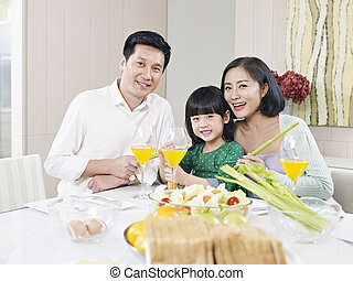 happy asian family - asian family having meal at home