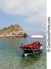 Boat at sicilian coast - Ioanian sea and boat near Taormina,...