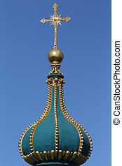 Golden cross on the church dome top