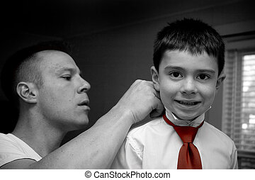 Father Helping Son Get Ready - A groom helps his son get...
