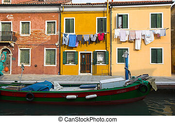 Boat in Burano - Old fisherman boat moored in Burano canal