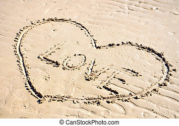 drawing a heart on the sand
