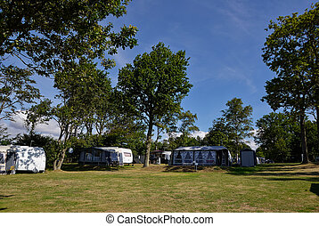 Campers in a camping site - Campers in a beautiful camping...