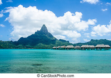 Overwater bungalows in Bora Bora with view of Mount Otemanu.