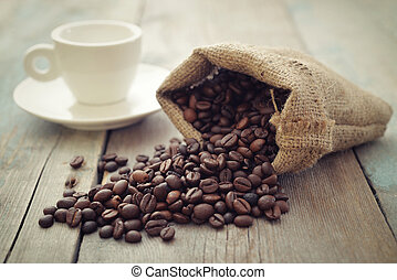 Sack of coffee beans with cup