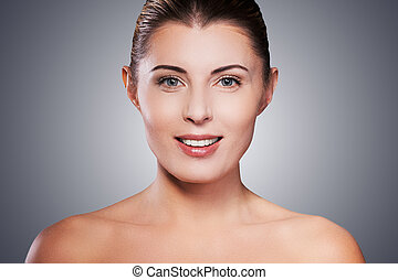 Natural beauty Portrait of shirtless mature woman smiling...