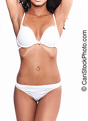 Beautiful body in shape Cropped image of woman in white bra...