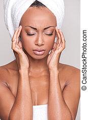 Feeling headache. Beautiful young Afro-American shirtless...